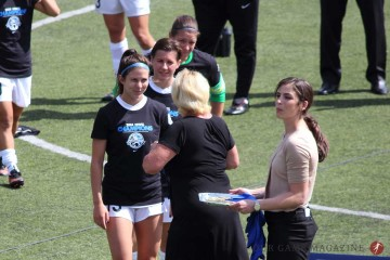 FC Kansas City's Erika Tymrak, Amy LePeilbet, and Nicole Barnhart accepting their medals from NWSL Executive Director Cheryl Bailey after the 2014 NWSL Championship game at Starfire Stadium on August 31, 2014.
