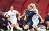 Eugénie Le Sommer getting past England's defense.