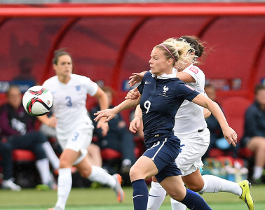 Eugénie Le Sommer getting past England's defense.