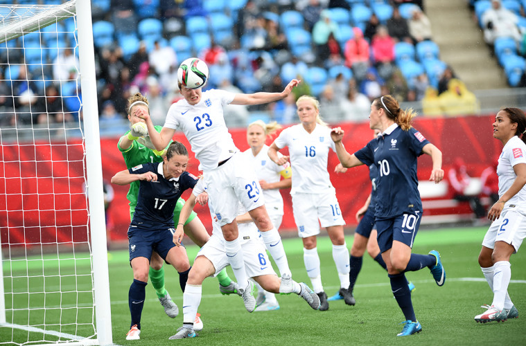 Ellen White (23) heads the ball away during the first half against France in Moncton, New Brunswick.