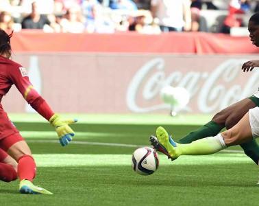 Julie Johnston tackles the ball away from Asisat Oshoala.