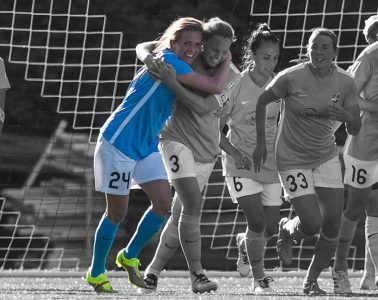 Kelly Conheeney hugged by Christie Rampone. ISI Photos.