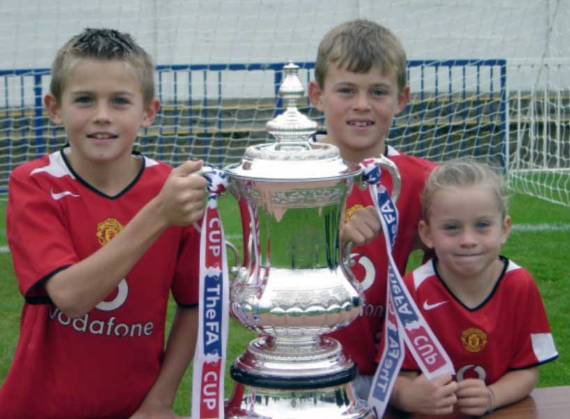 Alessia Russo with brothers as kids in Manchester United kits