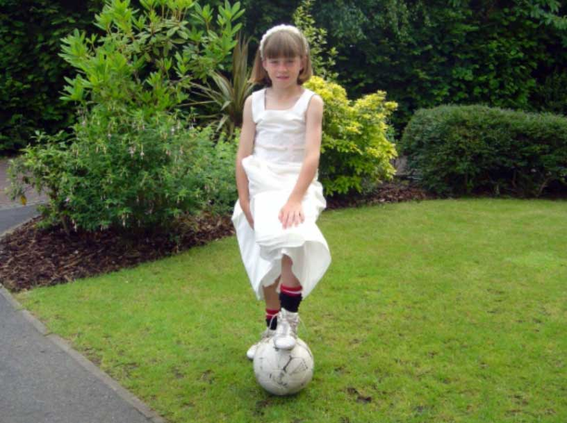 Alessia Russo as a young child in dress and cleats. (Russo family)