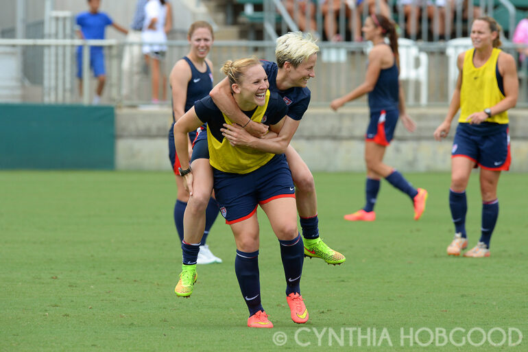 Amy Rodriguez gives Megan Rapinoe a lift during U.S. Women's National Team open training on August 19, 2014, in Cary, N.C.