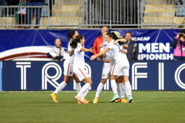 USWNT celebrates its 3-0 win over Mexico to qualify for the 2015 World Cup.