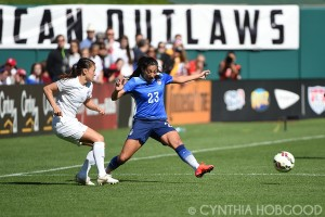 Ali Riley and Christen Press during a friendly at Busch Stadium on April 4, 2015.