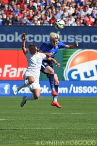 Annalie Longo and Megan Rapinoe battle for the ball during a friendly on April 4, 2015.