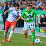 PSG's Kenza Dali and Wolfsburg's Noelle Maritz vie for the ball.