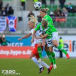 Caroline Seger (PSG), Martina Müller (25), and Alex Popp (right) challenge for the ball.