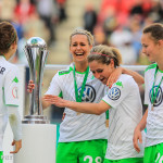 Lena Goeßling (WOB) holds onto the DFB-Pokal Cup after almost knocking it over.