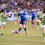 Megan Rapinoe (15) maneuvers between Mexican players.