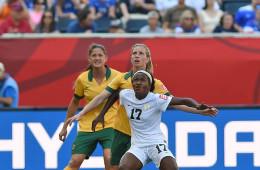 Nigeria's Francisca Ordega holds off the Australian defense.