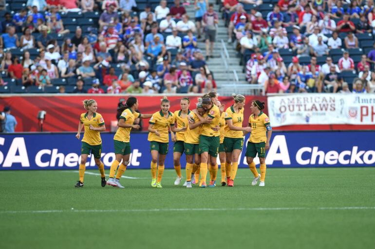 Australia celebrates Kyah Simon's second-half goal in a Group D match against Nigeria.
