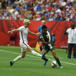 USA's Megan Rapinoe and Nigeria's Esther Sunday.