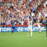 USA's Meghan Klingenberg and Becky Sauerbrunn celebrate the win over Nigeria.