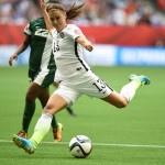 USA's Alex Morgan gets a shot off against Nigeria.