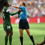 Nigeria's Evelyn Nwabuoku confers with the referee.