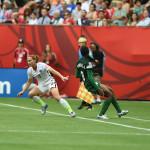 USA's Christie Rampone shields the ball from Nigeria's Asisat Oshoala.