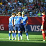 USA's defense huddles before the match against Sweden.
