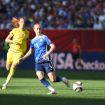 USA's Becky Sauerbrunn clears the ball.