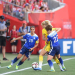 Sweden's Sofia Jakobsson is surrounded by USA's Carli Lloyd and Meghan Klingenberg.