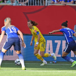 Sweden's Lotta Schelin against USA's Julie Johnston and Ali Krieger.