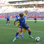 USA's Meghan Klingenberg shields the ball from Sweden's Sofia Jakobsson.