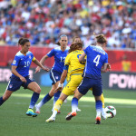 Sweden's Lotta Schelin is surrounded by USA's Carli Lloyd, Lauren Holdiay, and Becky Sauerbrunn.
