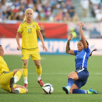 Sweden's Lina Nilsson and USA's Sydney Leroux going for the ball.