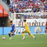 USA's Ali Krieger gets to the ball before Sweden's Lina Nilsson.