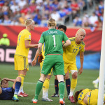 The aftermath of a collision between USA's Carli Lloyd and Sweden's Jessica Samuelsson.