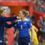 USA's head coach Jill Ellis instructs Amy Rodriguez.