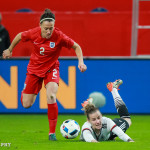 Lucy Bronze (ENG) and Simone Laudehr (GER) vie for the ball.