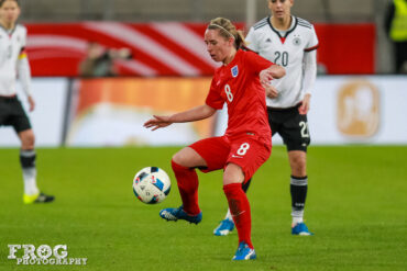 Jordan Nobbs controls the ball.