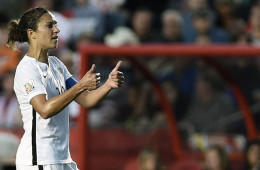 Carli Lloyd giving a thumbs-up.