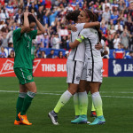 Alex Morgan congratulating Carli Lloyd on her goal.