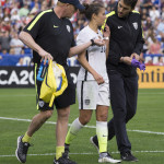 The aftermath of Carli Lloyd's collision with a player from Ireland.
