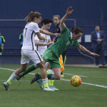 USA's Tobin Heath explaining gravity to Ireland's Aine O'Gorman.