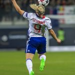 Eugénie Le Sommer (OL). She trapped and controlled this.