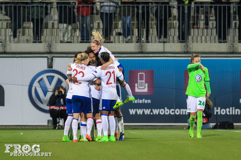 OL celebrates Camille Abily's goal. Le Sommer gets air.