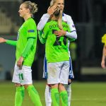 Ada Hegerberg (OL) comforts Lara Dickenmann (WOB) after the match.