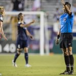 Allie Long in discussion with the referee Shane Lardinois).
