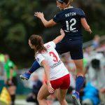 Ashley Hatch rises for the header. (Shane Lardinois)