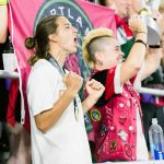 Tobin Heath celebrating with the Thorns fans after winning the 2017 NWSL Championship. (Monica Simoes)
