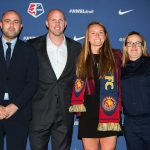 EJ Proctor with Utah Royals head coach Laura Harvey and staff (Monica Simoes).