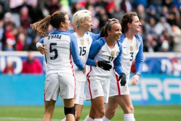 Kelley O'Hara, Megan Rapinoe, and Andi Sullivan celebrate Mallory Pugh's goal (11) during the 2018 SheBelieves Cup. (Monica Simoes)