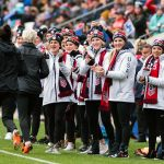 The U.S. Women's National Hockey Team greets the U.S. Women's National Soccer Team during warmups at the 2018 SheBelieves Cup. (Monica Simoes)
