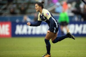 Debinha celebrates after scoring. (Shane Lardinois)