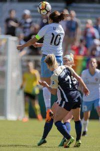 Carli Lloyd heads the ball. (Shane Lardinois)